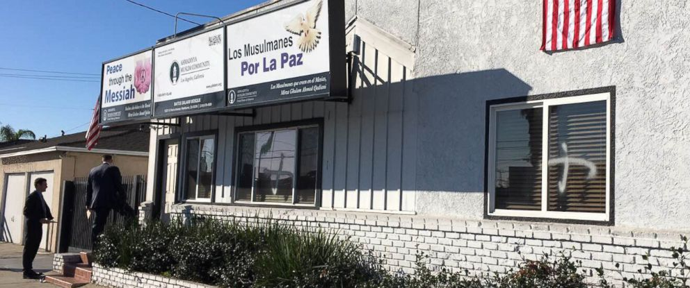 PHOTO:This photo provided by the Ahmadiyya Muslim Community muslimsforpeace.org shows crosses in spray paint vandalizing windows at the Ahmadiyya Muslim Community Baitus-Salaam Mosque in Hawthorne, Calif., Dec. 13, 2015.