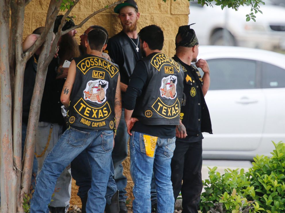 PHOTO: Bikers congregate against a wall while authorities investigate a Twin Peaks restaurant