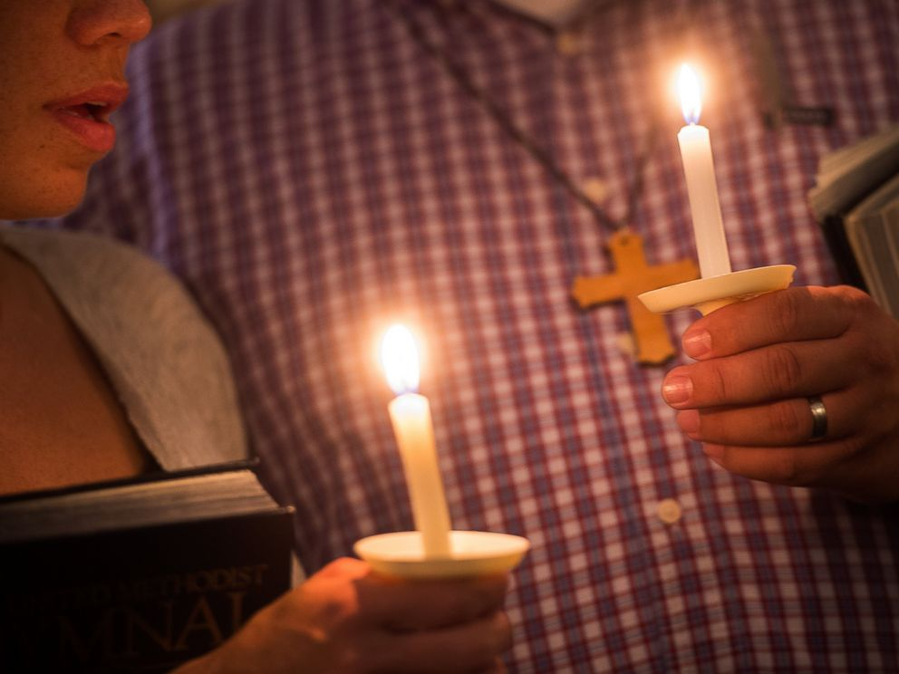 PHOTO: Community supporters light candles in the shape of a heart during a vigil for journalists Alison Parker and Adam Ward who were killed during a shooting in Moneta, Va., Aug. 26, 2015.