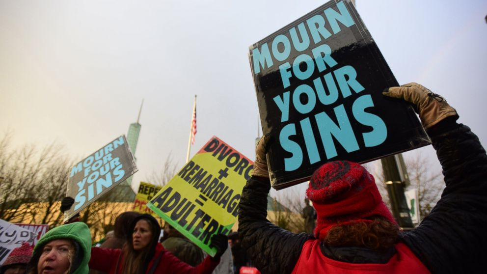 Westboro Baptist Church members take part in a picket outside of the Gay Christian Network Conference held at the Convention Center in Portland, Ore., Jan. 10, 2015.
