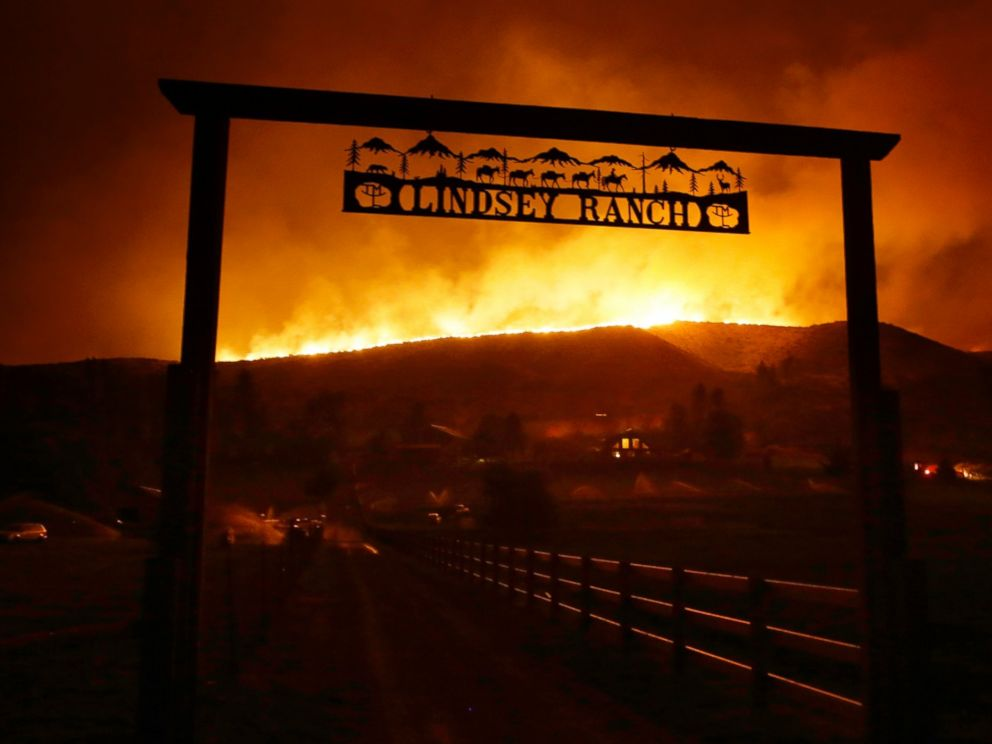 PHOTO: Fire burns on the ridge above a ranch on Twisp River Road in Twisp, Wash., Aug. 19, 2015.