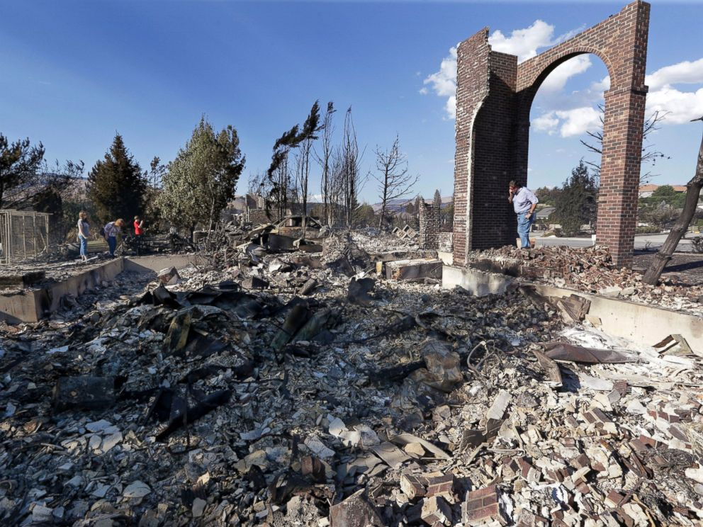 PHOTO: A man stands in front of the remains of his fire-destroyed home, June 29, 2015, in Wenatchee, Wash.