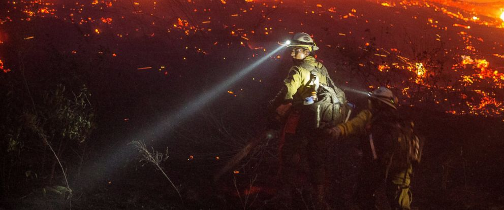 PHOTO: U.S. Forest Service fire fighters cut brush near houses, June 28, 2015, in northern Wenatchee, Wash.