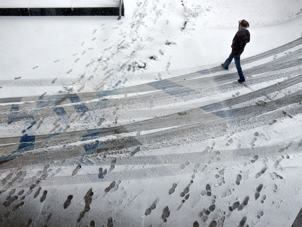 PHOTO: A man walks in the snow near the entrance to the St. Cloud Public Library, Nov. 18, 2016 in St. Cloud, Minnesota.