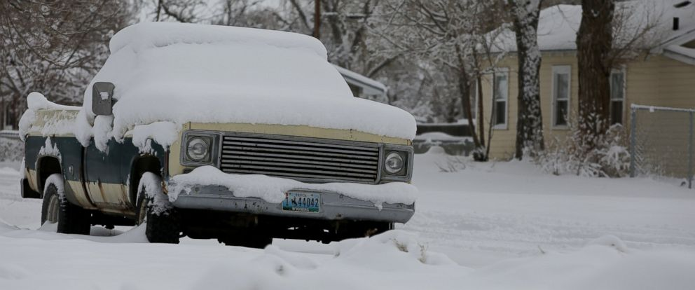PHOTO: A pickup sits covered in snow Tuesday, March 3, 2015 on East M Street in north Casper, Wyo.