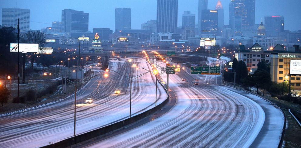 PHOTO: Sparse traffic makes its way on the Interstate 75/85 connector just south of downtown Atlanta, early Feb. 12, 2014.