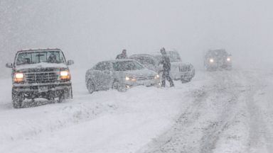 PHOTO: Cars are seen off the side of the road that evidently spun out on I-43 northbound at N. Port Washington Rd. near Port Washington, Wis., Sunday, Dec. 22, 2013.