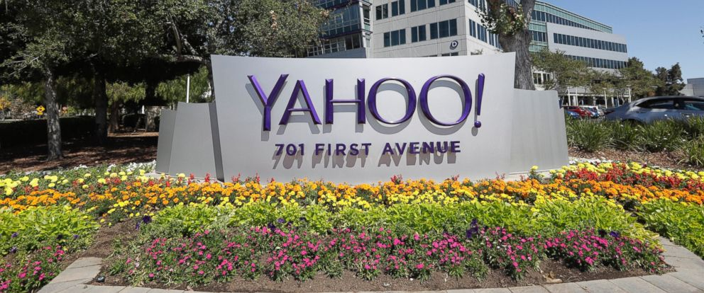 PHOTO: Flowers bloom in front of a Yahoo sign at the companys headquarters, July 19, 2016, in Sunnyvale, California.