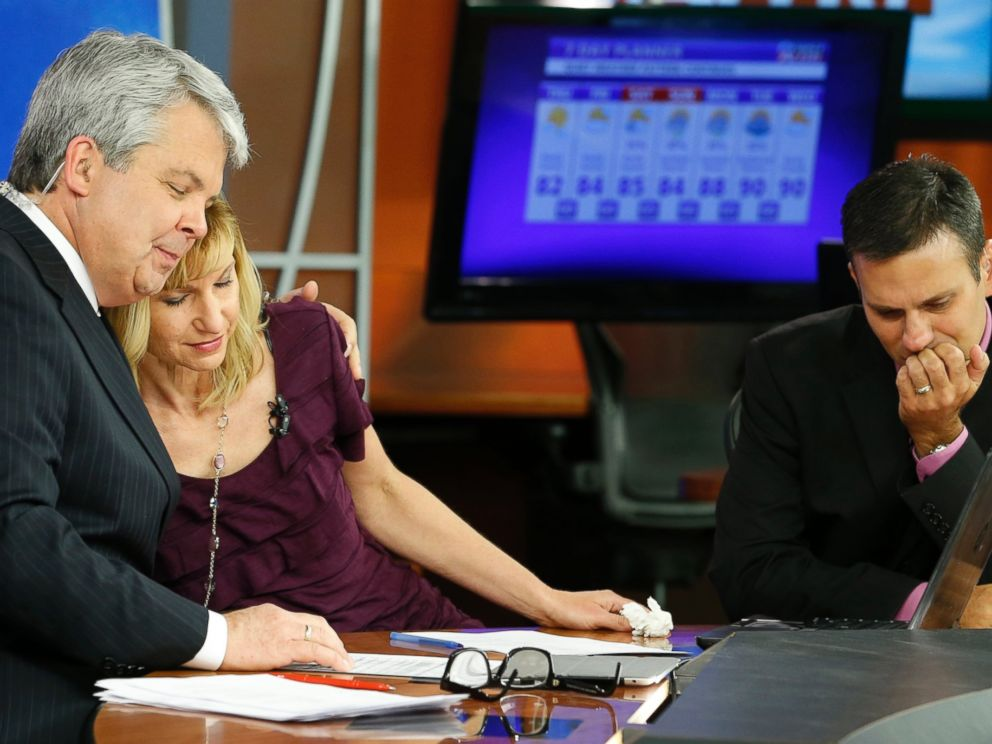 PHOTO:WDBJ-TV7 news morning anchor Kimberly McBroom, center, gets a hug from visiting anchor Steve Grant, left, as meteorologist Leo Hirsbrunner reflects after their early morning newscast at the station, Aug. 27, 2015, in Roanoke, Va.