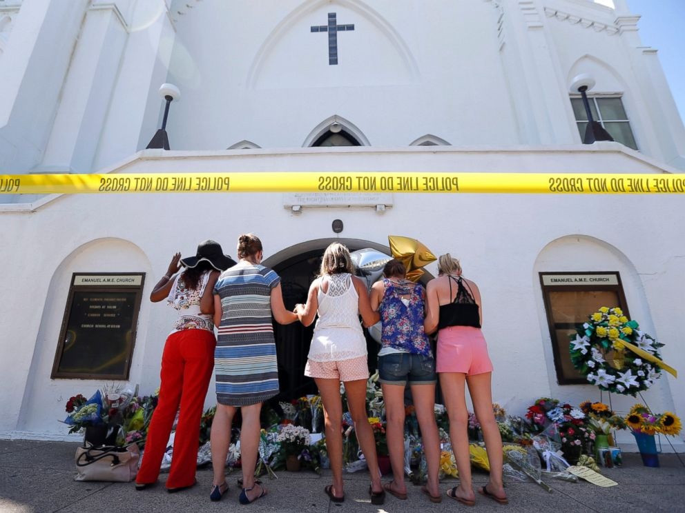 PHOTO:A group of women pray together at a make-shift memorial on the sidewalk in front of the Emanuel AME Church, June 18, 2015 in Charleston, S.C.