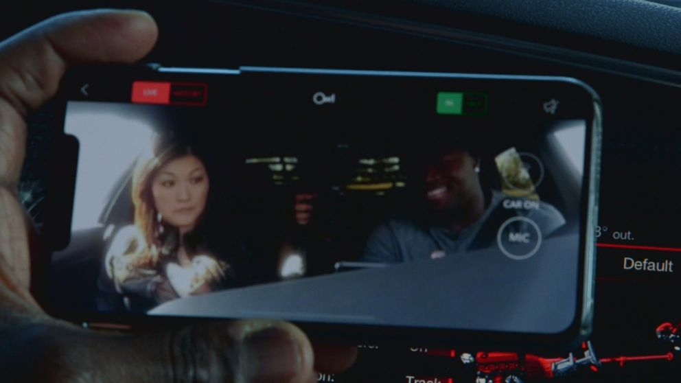 Carolina Panthers fullback Alex Armah shows Nightline's Juju Chang the small security camera on the dashboard of his treasured Dodge Charger.