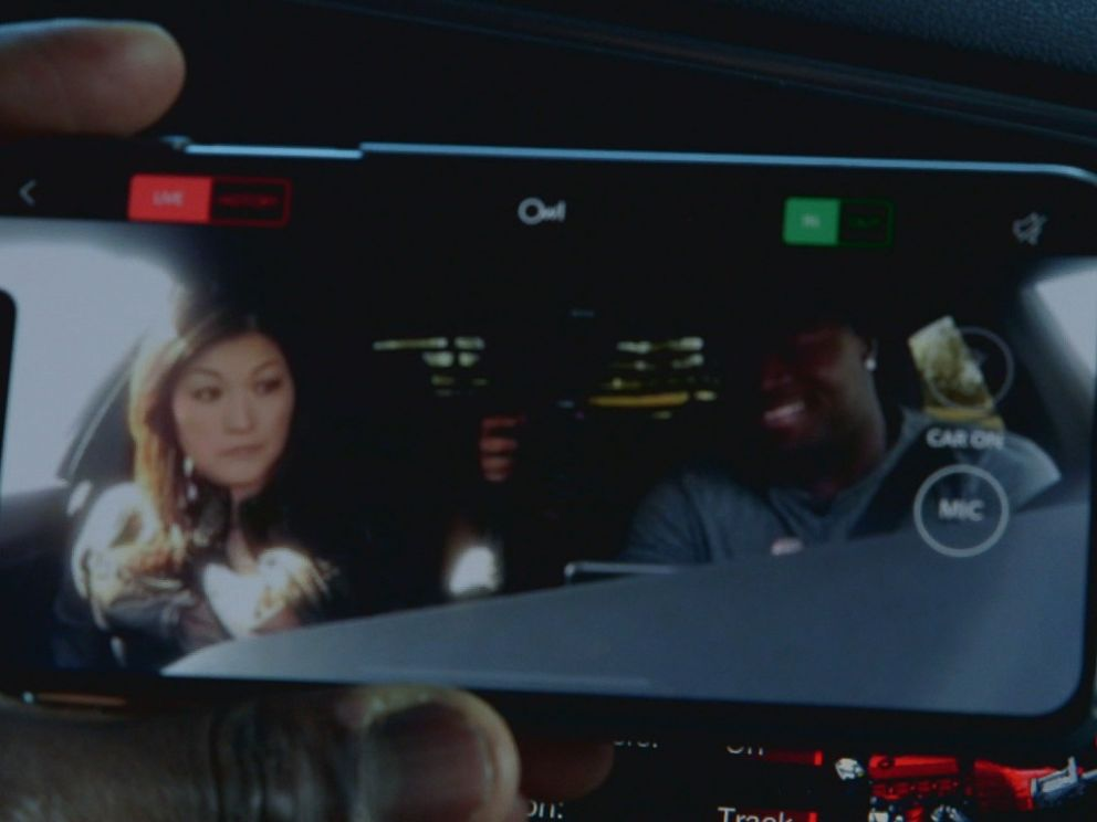 PHOTO: Carolina Panthers fullback Alex Armah shows Nightlines Juju Chang the small security camera on the dashboard of his treasured Dodge Charger.