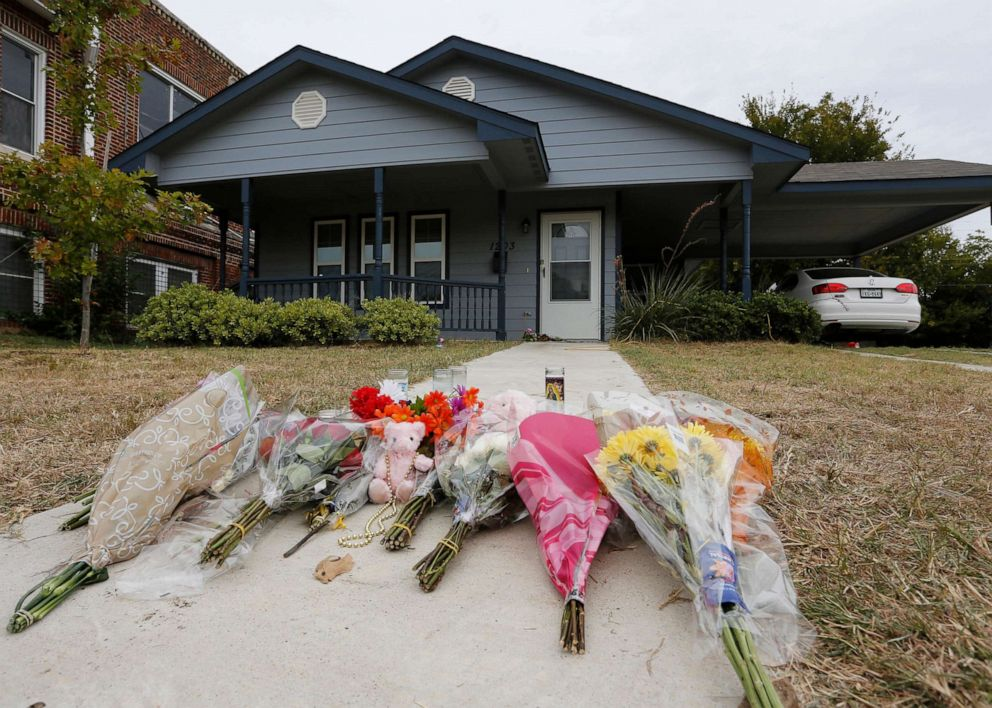 PHOTO: Flowers lie on the sidewalk in front of the house, Oct. 14, 2019, in Fort Worth, Texas, where a police officer shot and killed Atatiana Jefferson, through a back window of her home.