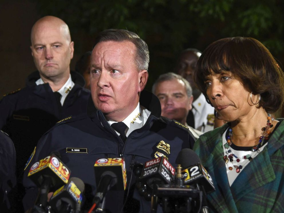 PHOTO: Police commissioner Kevin Davis, center, talks to the press after a police officer was shot, as States Attorney for Baltimore Marilyn Mosby, left, and Baltimore Mayor Catherine Pugh, right, stand nearby, Nov. 15, 2017, in Baltimore.