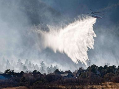 Wildfires continue to burn in west as warmer temperatures head east