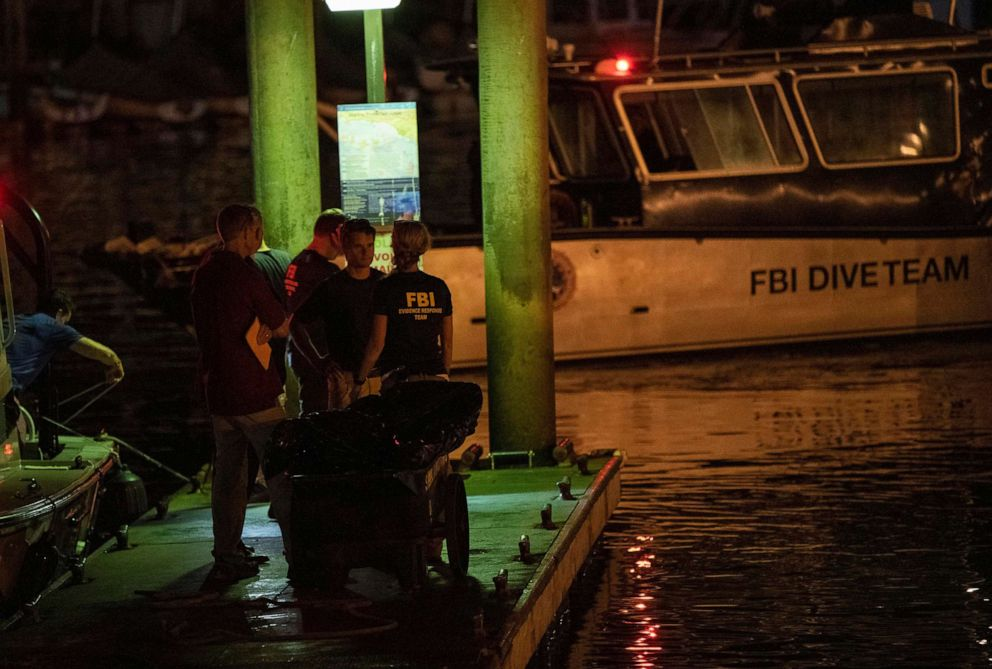 PHOTO:Authorities and FBI investigators cart away evidence taken from the scuba boat Conception in Santa Barbara Harbor at the end of their second day searching for the remaining missing divers, Sept. 3, 2019, in Santa Barbara, Calif.