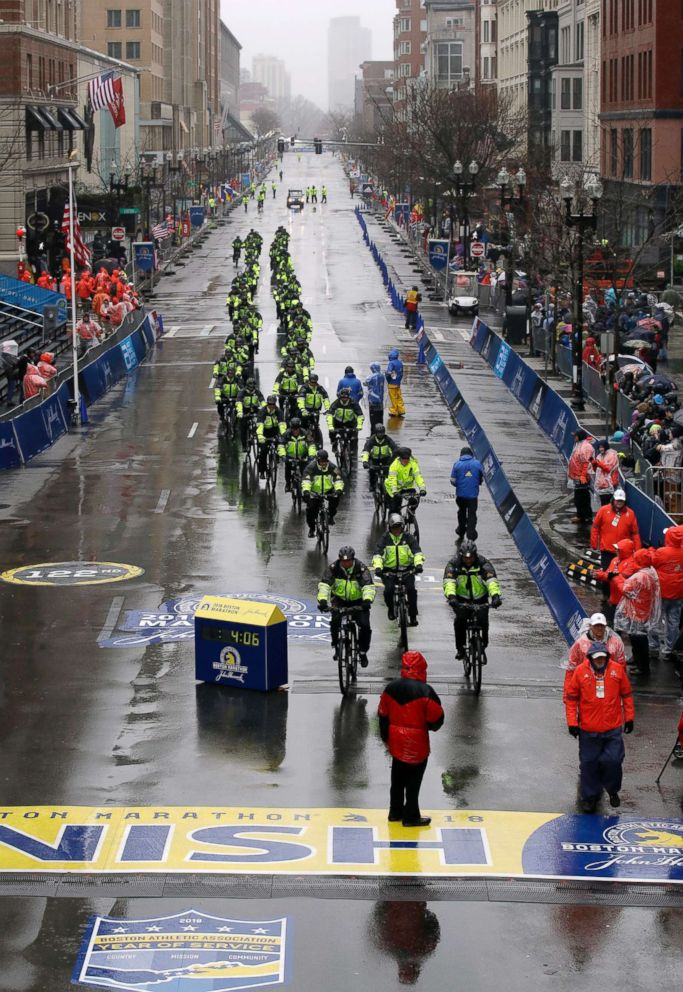 PHOTO: Bicycle-mounted police officers patrol at the finish line before the 122nd Boston Marathon, April 16, 2018, in Boston.