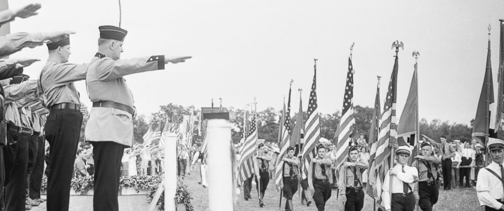 PHOTO:The leaders of German American Bund give the Nazi salute to young men and women marching in Nazi uniforms, Aug.29, 1937 in Yaphank, New York .