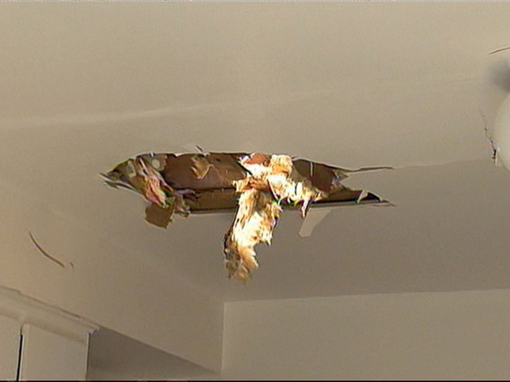 PHOTO: A jet wheel fell through the roof of a Montreal home, June 24, 2015.