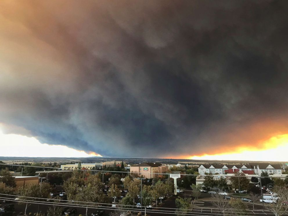 PHOTO: The massive plume from the Camp Fire, burning in the Feather River Canyon near Paradise, Calif., wafts over the Sacramento Valley as seen from Chico, Calif., Nov. 8, 2018.
