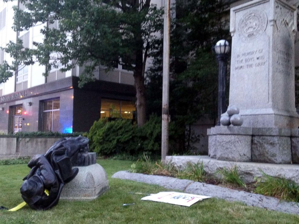 PHOTO: A toppled Confederate statue lies on the ground on Aug. 14, 2017, in Durham, N.C. Activists on Monday evening used a rope to pull down the monument outside a Durham courthouse in response to the events in Charlottesville over the weekend.