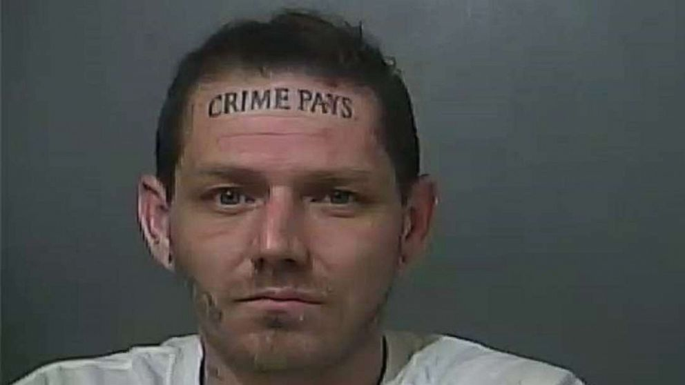 Man with huge forehead tattoo saying 'crime pays' back in jail again after police chase