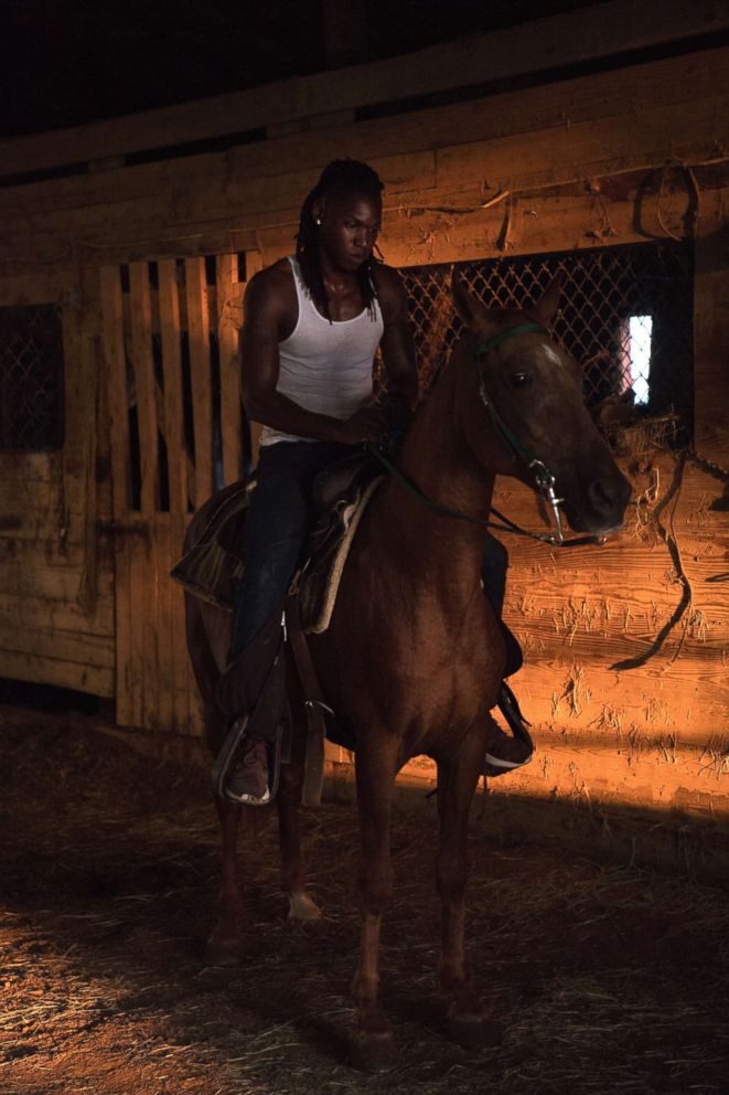 A cowboy named Kyran poses for a portrait at his horse barn near Cleveland, Miss.