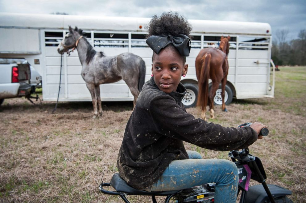 Bre looks back for her friends at a horse show in Charleston, Miss.