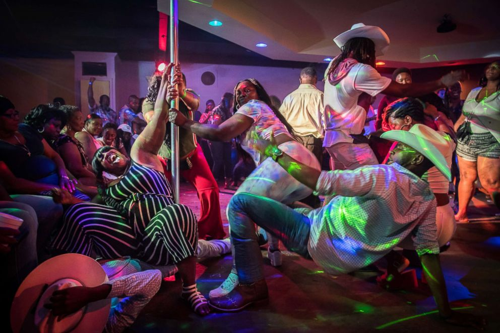 A group of cowboys and dancers take to the dance floor at Club Black Castle in Ruleville, Miss.