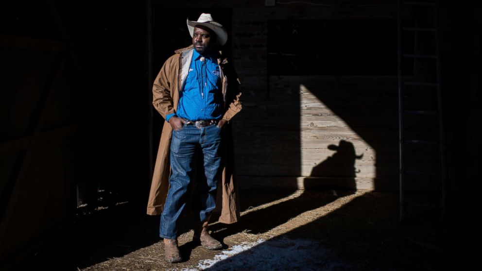 A cowboy named Jessie poses for a portrait at his barn near Cleveland, Miss.