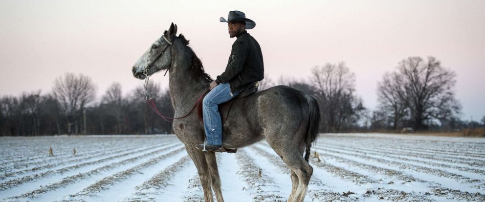 PHOTO: Gee stands with his horse after a rare snowfall in Bolivar County, Miss