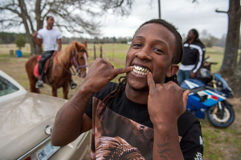PHOTO: Ladarius shows off his golden grill at a trail ride in Charleston, Miss.