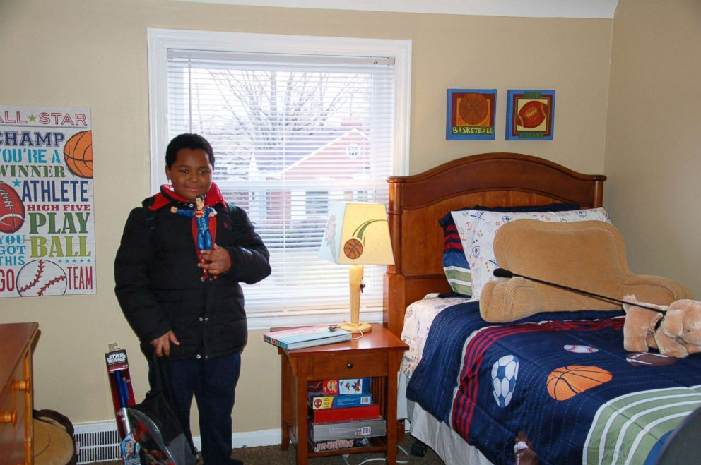 PHOTO: Daerye Neely, 8, shows off his new room in Detroit.