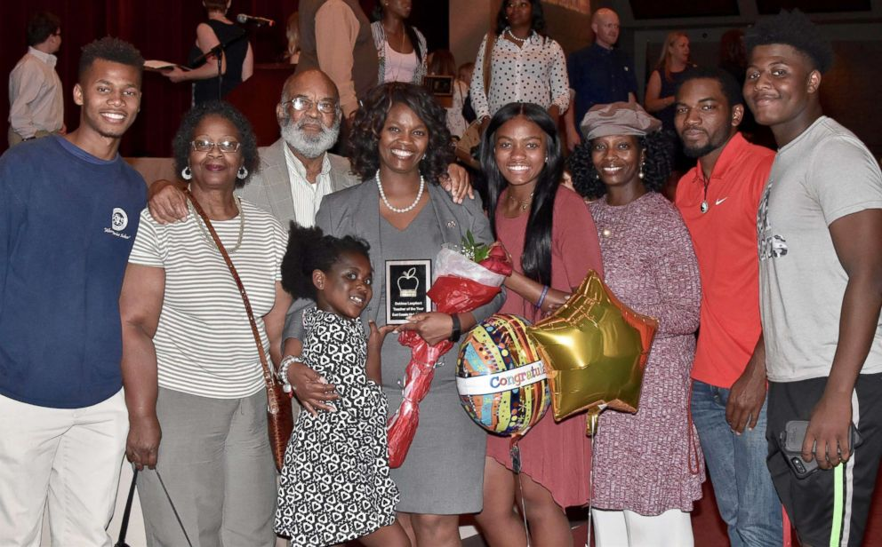 PHOTO: Dawn Muhammad is photographed here with her father, Lucious Daniels, and their family.