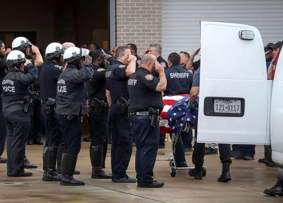 PHOTO: Law enforcement officers escort the body of Deputy Sandeep Dhaliwal, who was shot and killed after a traffic stop in Cypress earlier in the day, to the Harris County Institute of Forensic Sciences on Friday, Sept. 27, 2019, in Houston.