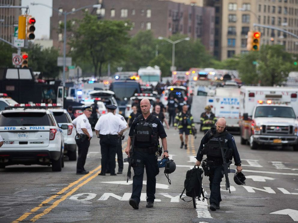 PHOTO: Officers walk away after a shooter opened fire, killing at least one doctor before committing suicide at the Bronx-Lebanon Hospital Center in the Bronx, New York, June 13, 2017.