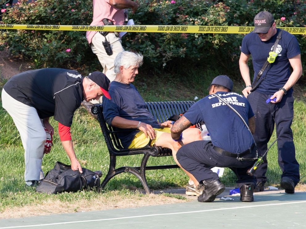 PHOTO: Rep. Roger Williams receives medical attention from first responders on the scene following a shooting in Alexandria, Va., June 14, 2017.