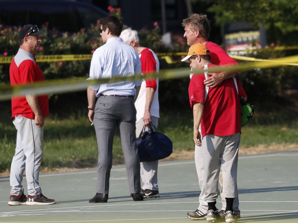 PHOTO: Republican Senator from Arizona Jeff Flake hugs another member of the Republican congressional baseball team following a shooting in Alexandria, Va., June 14, 2017.