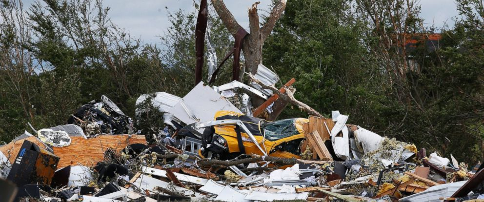 PHOTO: Cars and damaged material is seen piled up at a local car dealership that was destroyed when a large tornado hit the area near Canton, Texas, April 30, 2017.