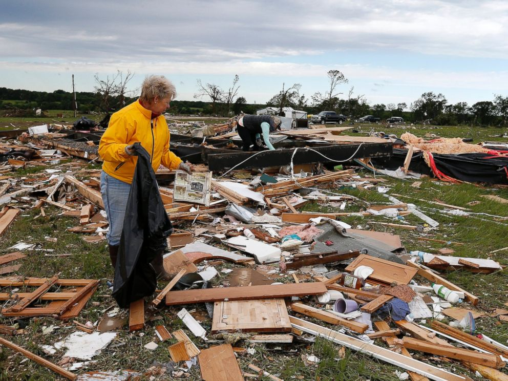 PHOTO: Two women retrieve items for their neighbor from the remains of their trailer home that was destroyed when a large tornado hit the area near Canton, Texas, April 30, 2017.