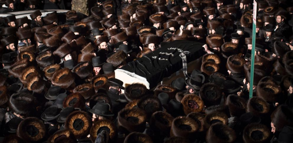 PHOTO: A handout picture made available by Insider Images shows mourners carrying the coffin of Menachem Stark at his funeral in Brooklyn, New York on Jan. 4, 2014.