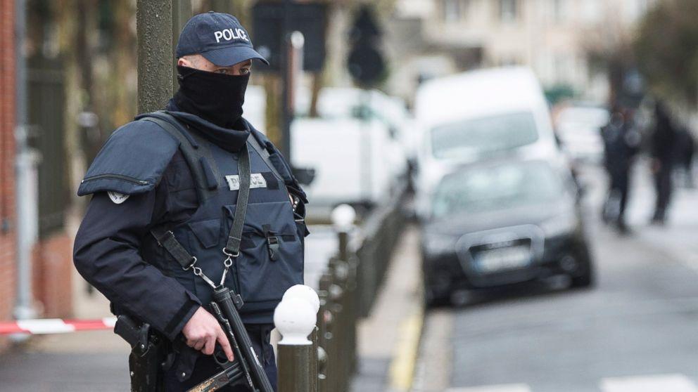 A police officer stands outside a building where an anti-terrorism operation took place in Argenteuil, near Paris, March, 25 2016.