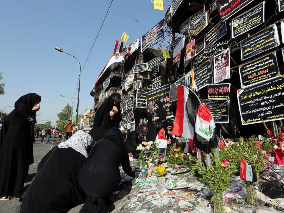 PHOTO: Iraqi women take part in a prayer vigil at the site of a suicide truck bomb attack in Karada district in central Baghdad, Iraq, July 6, 2016.