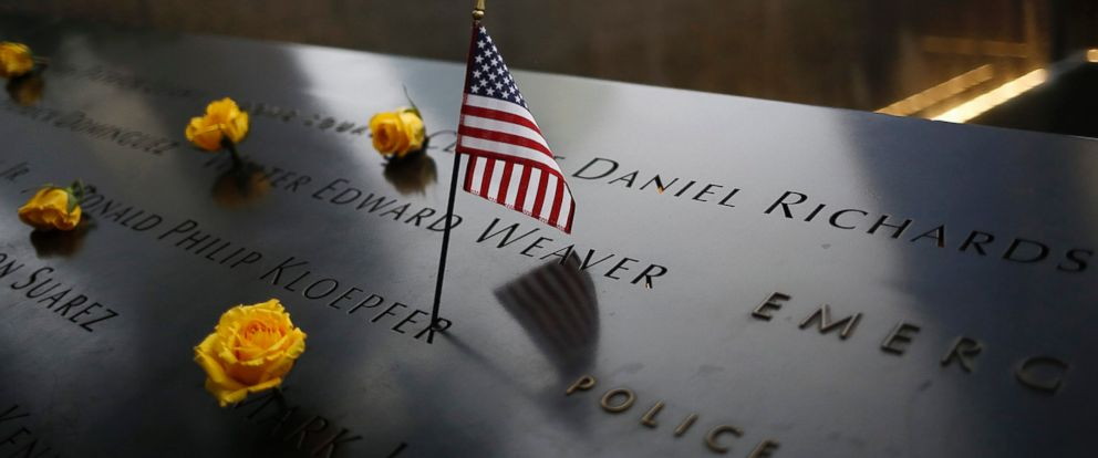 PHOTO: An American flag stands amongst names on the 9/11 memorial before the start of the 15th anniversary memorial service to 9/11 victims, Sept. 11, 2016, in New York City.