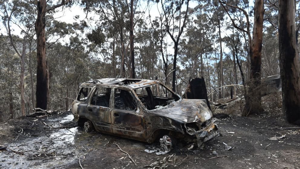 A fire damaged car is seen at Wye River in the Otway Ranges south of Melbourne, Australia, Dec. 27, 2015.