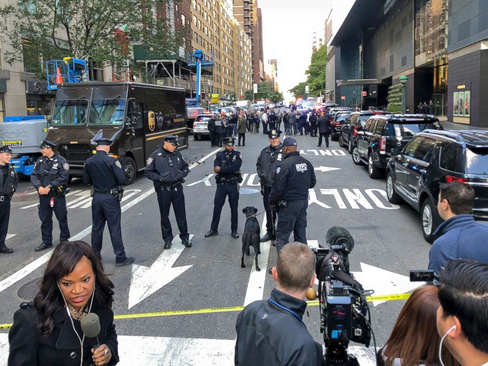 PHOTO: New York Police stand outside the Time Warner Center at Columbus Circle, on Oct. 24, 2018 in New York. A police bomb squad was sent to CNNs offices at the center, and the newsroom was evacuated because of a suspicious package.