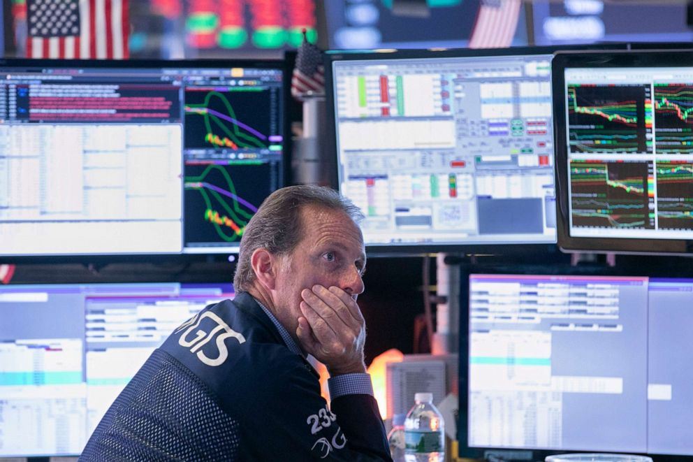 PHOTO: Specialist Glenn Carrel works at his post on the floor of the New York Stock Exchange, Aug. 14, 2019.