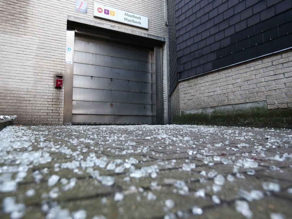 PHOTO: Broken glass is seen outside an entrance to Maelbeek metro station following the attacks on March 22, 2016 in Brussels, Belgium.