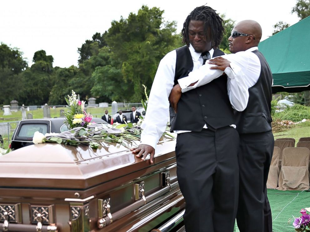 PHOTO: Brandon Risher, left, is comforted beside the casket of his grandmother, Ethel Lance, 70, one of nine victims of a mass shooting at the Emanuel AME Church, June 25, 2015 in North Charleston, S.C.