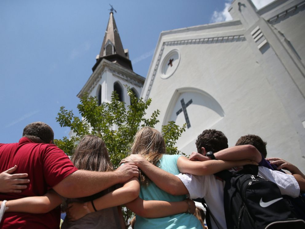 PHOTO: A church youth group from Dothan, Alabama prays in front of the Emanuel AME Church on the one-month anniversary of the mass shooting, July 17, 2015, in Charleston, S.C.